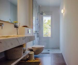 Cuartos de baño de mármol y granito en Ibiza