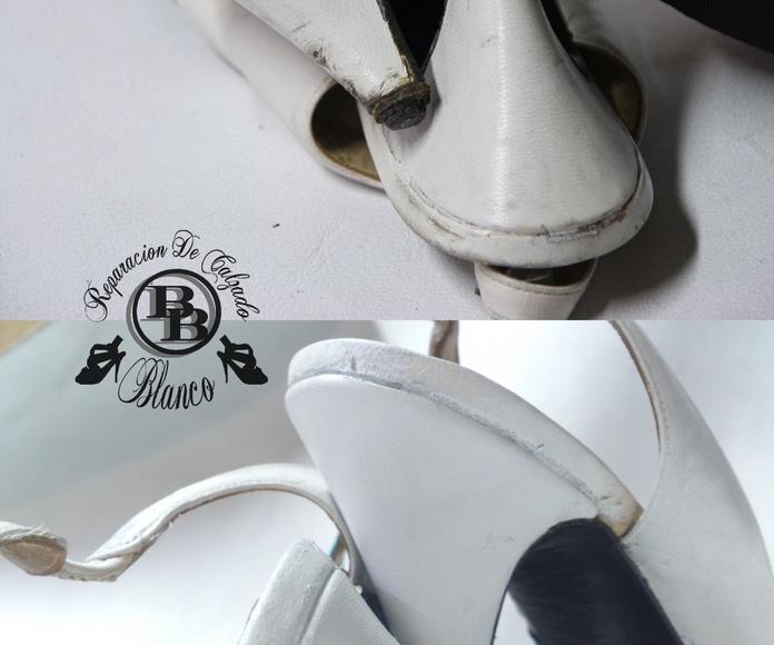 Cambio y forrado de tacones en piel blanca