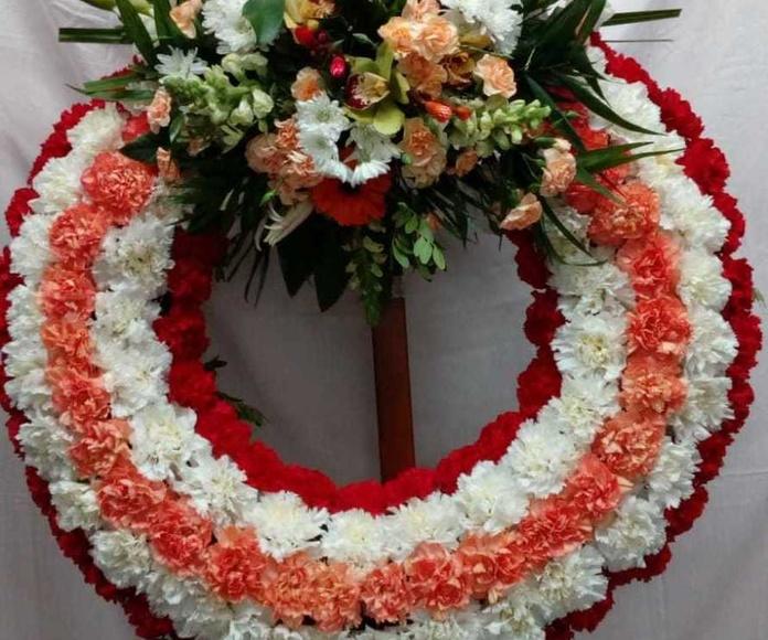 Arte funerario: Servicios de Floristería, Perfumería, Pajarería Herboflor