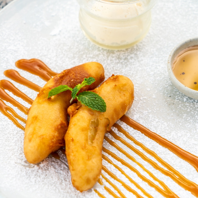 Postre: Plátano frito con miel o nata: Carta y menús de Yoshino