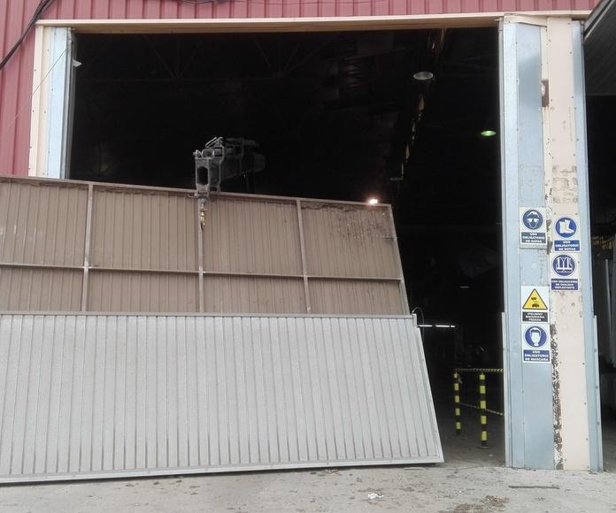 puerta basculante pre leva golpeada ROMANI Valencia1