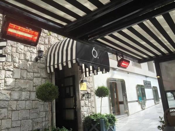 Instalaciones de electricidad: calefactores eléctricos en una terraza en Ávila