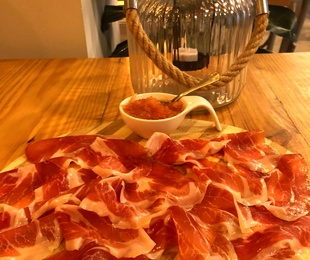 Spanish Iberian ham board with grated tomato