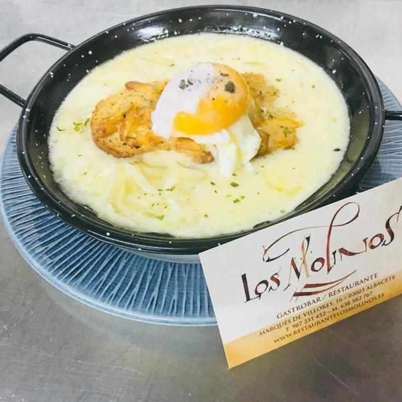 Huevos rotos con crema de Foie y Trufa