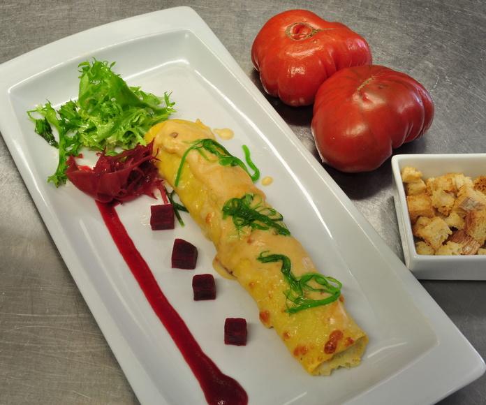 Gran canelón de bacalao, bechamel de marisco y bouquet de algas wakame y roja tohsaka