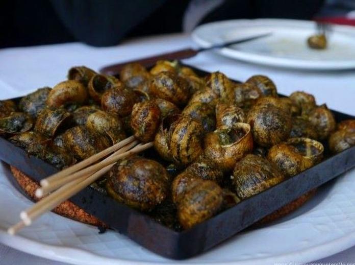 Especialidad: Caracoles a la Llauna: Cocina Catalana de Restaurant Astoria
