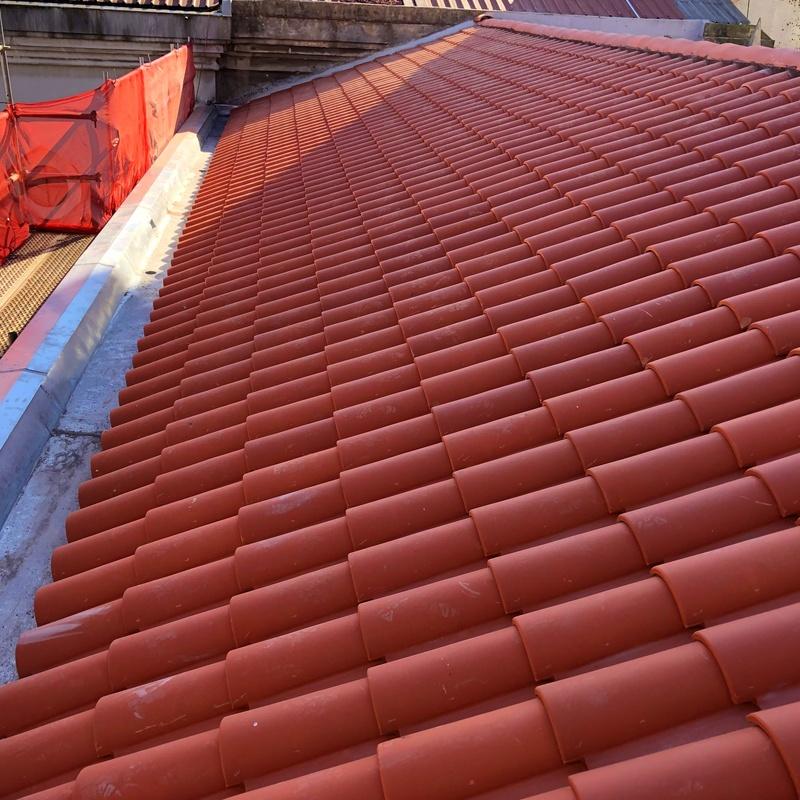 rehabilitación de tejado con teja mixta en Santander - Fachadas Cantabria