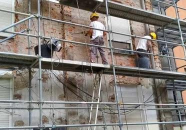 Picar y revocar fachada uralita en Santander-Torrelavega