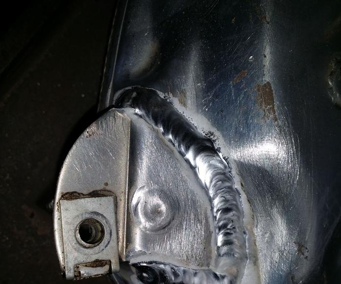 reparacion patilla tubo escape de moto