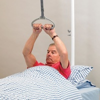Trapecio de ayuda en la cama