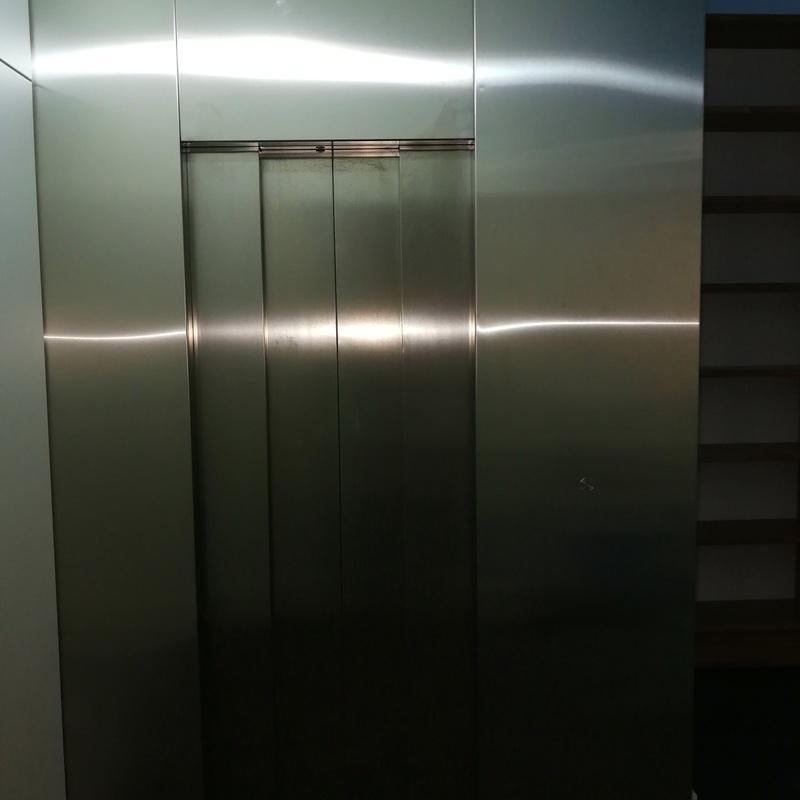 Forros de frente de ascensor fabricado con chapa de acero inoxidable satinado