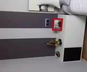 Dormitorio en estancia abuhardillada. Muebles a medida