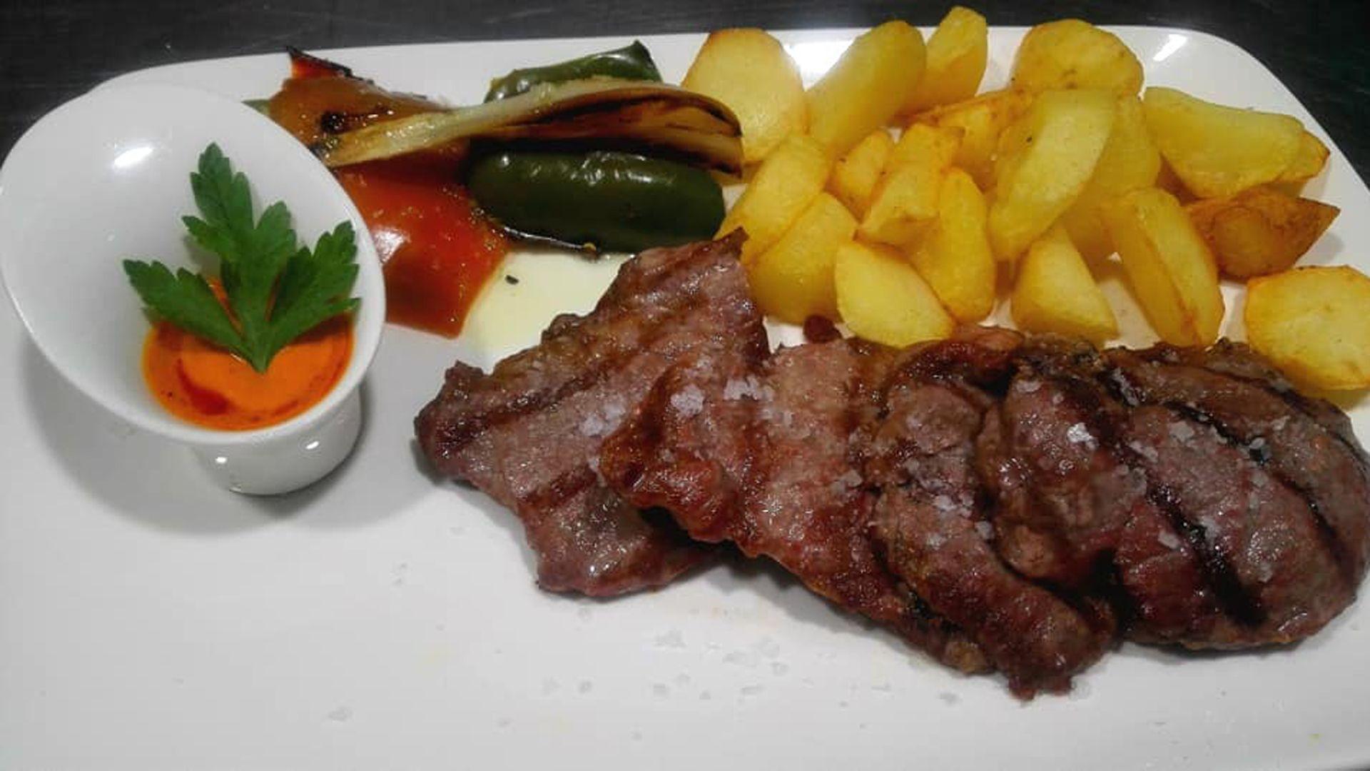 Carnes y pescados a la brasa en Conil de la Frontera