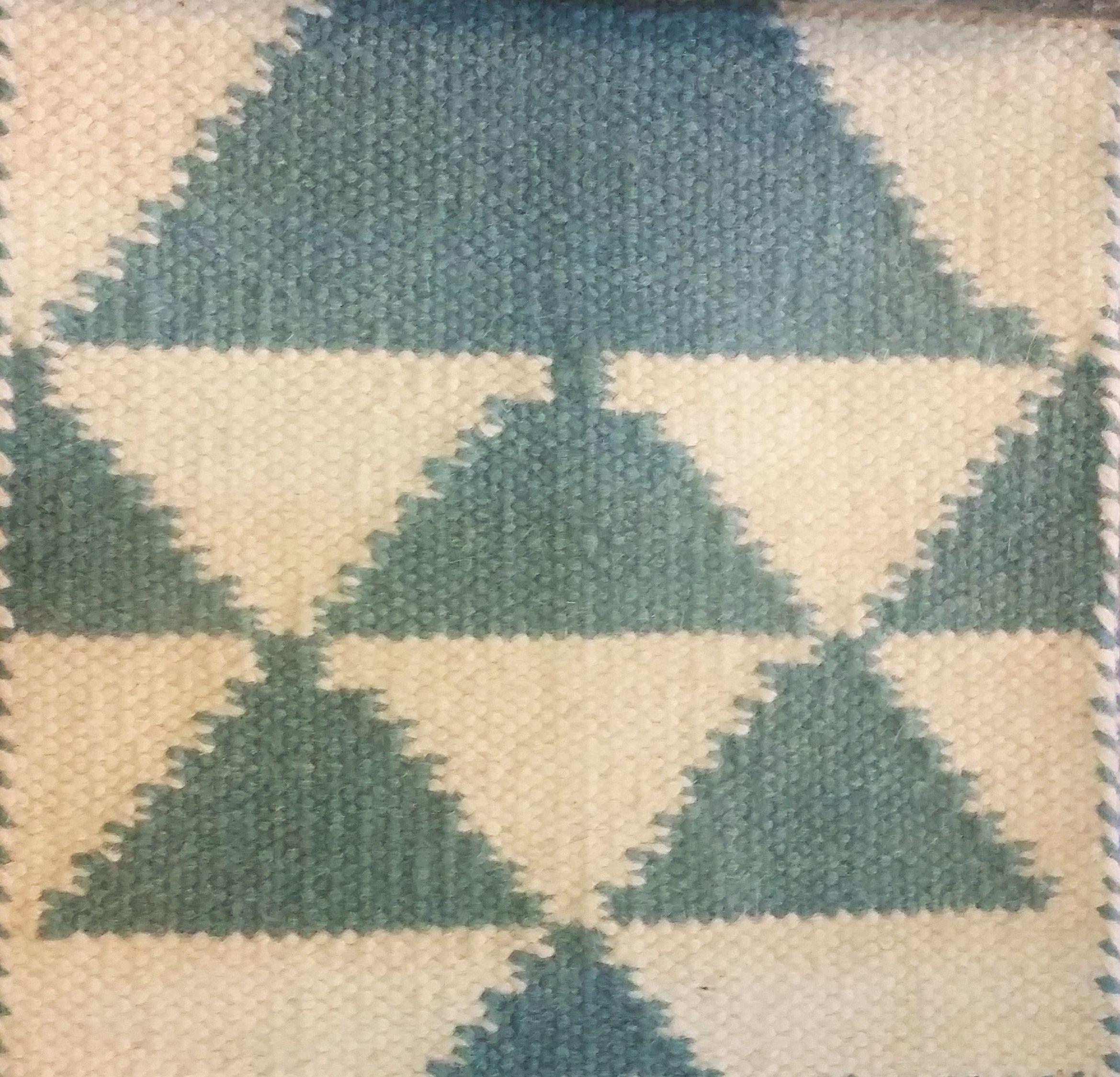 Precioso diseño en alfombra de lana manual