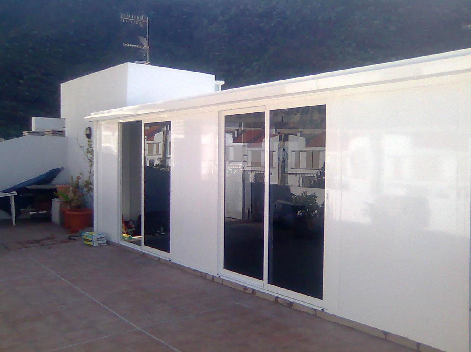 Obra de reforma para Cerramiento de aluminio  creación de habitación en azotea de vivienda en Santa Cruz de Tenerife