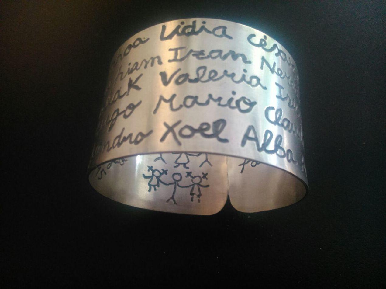 R/ 301 Brazalete plata 1ª ley  para regalar a profesoras