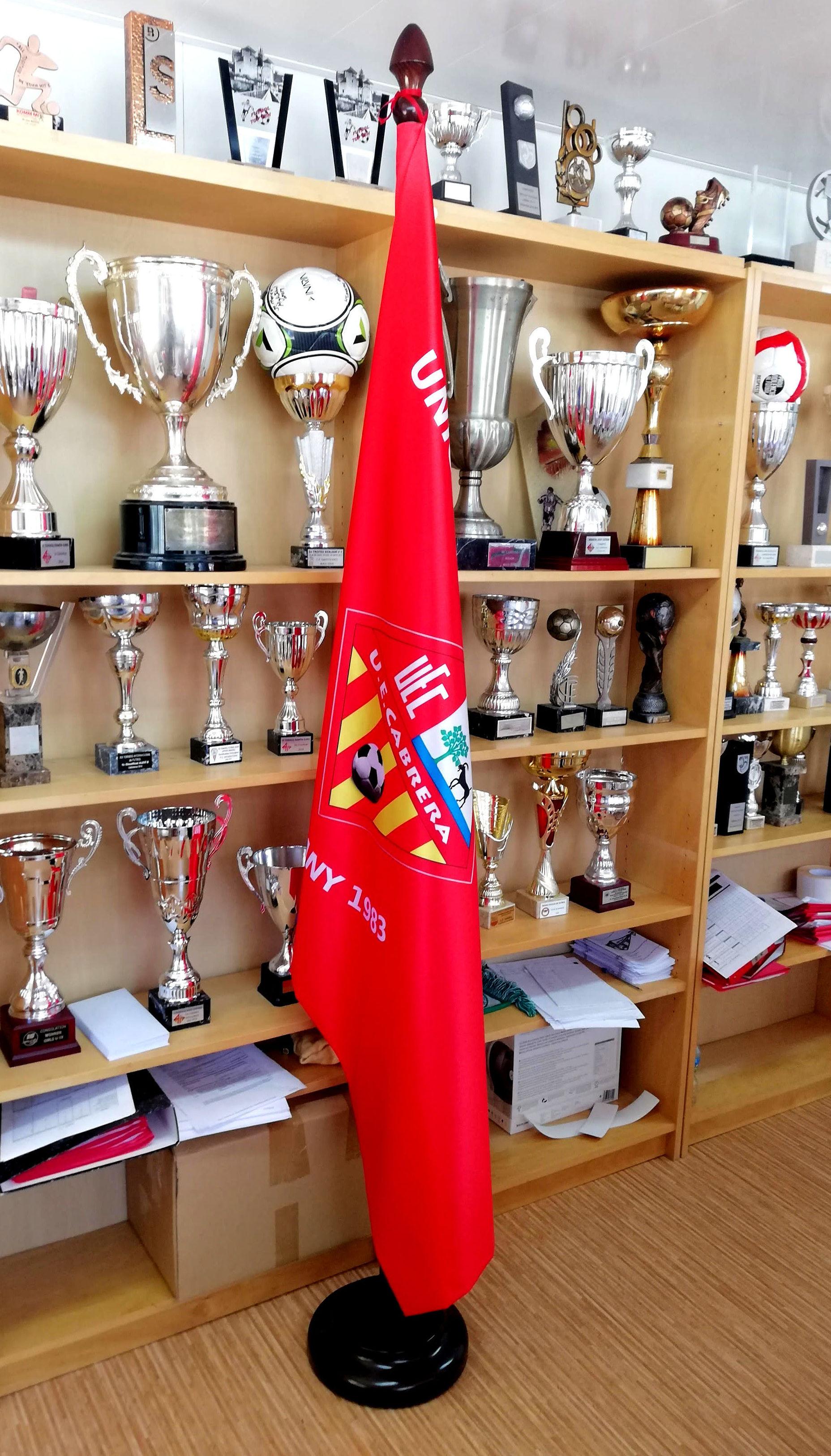 Bandera y mástil de Interior.