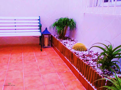 Rehabilitación de patio interior }}