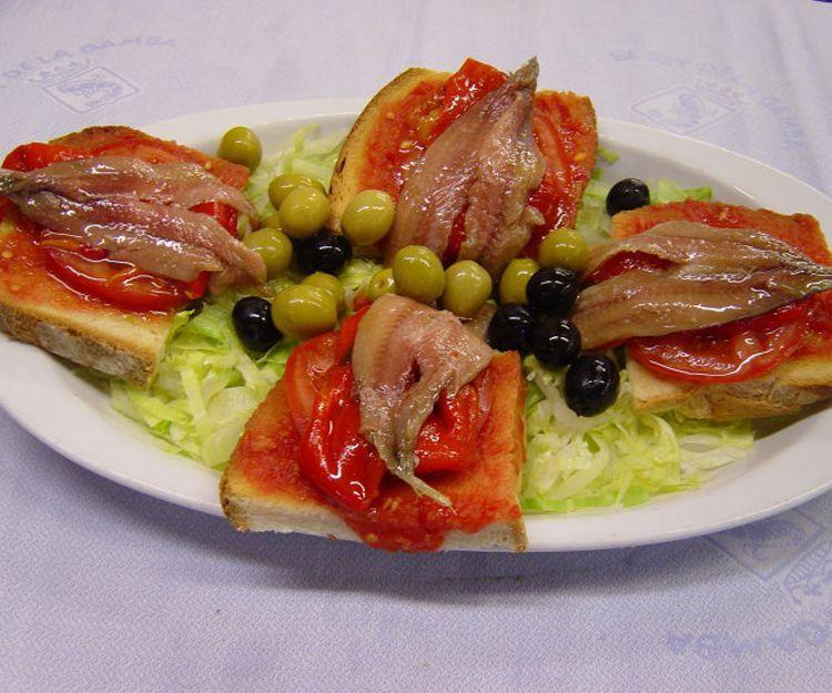 Pan con tomate y anchoas en Barcelona