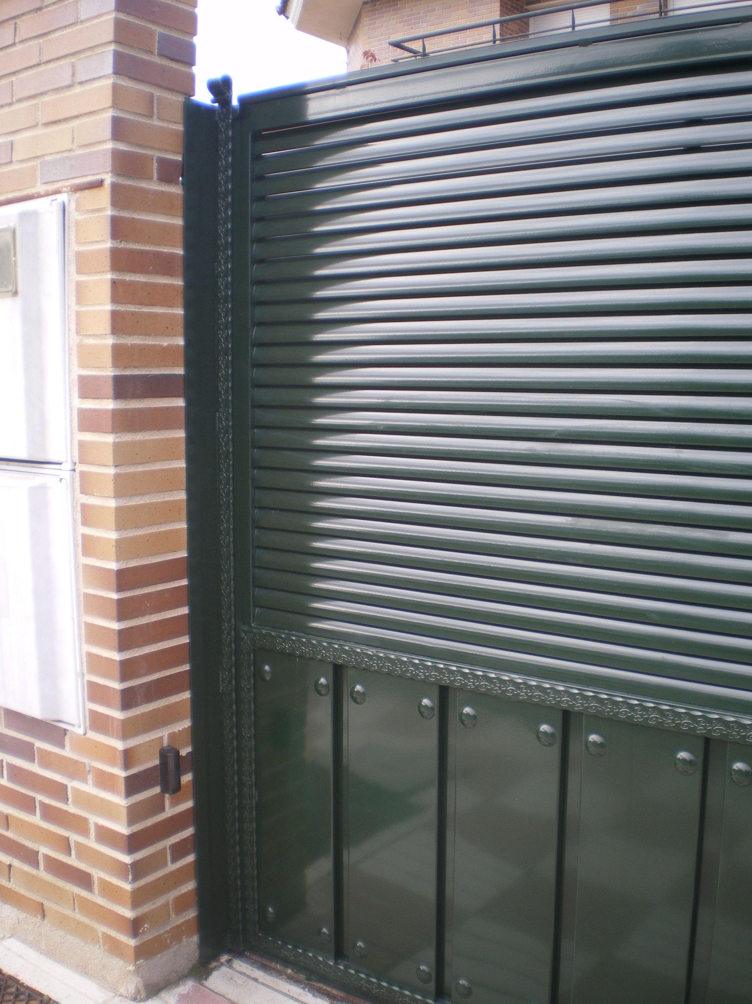 P23 - Puertas de entrada,garaje,comunidades