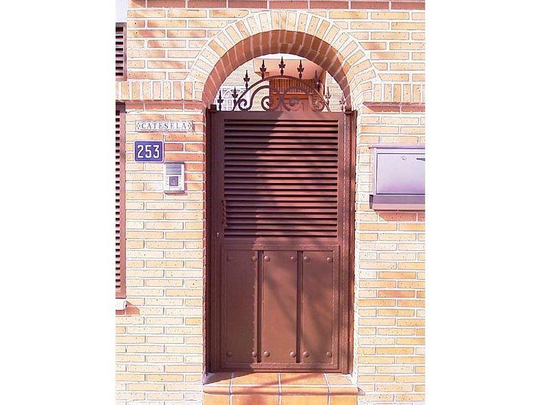 P7 - Puertas de entrada,garaje,comunidades