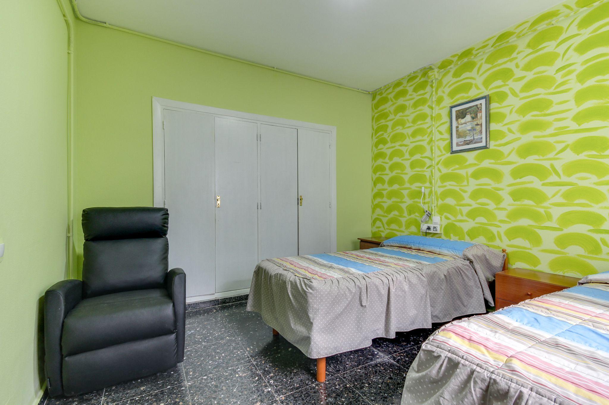 Habitación tonos verdes