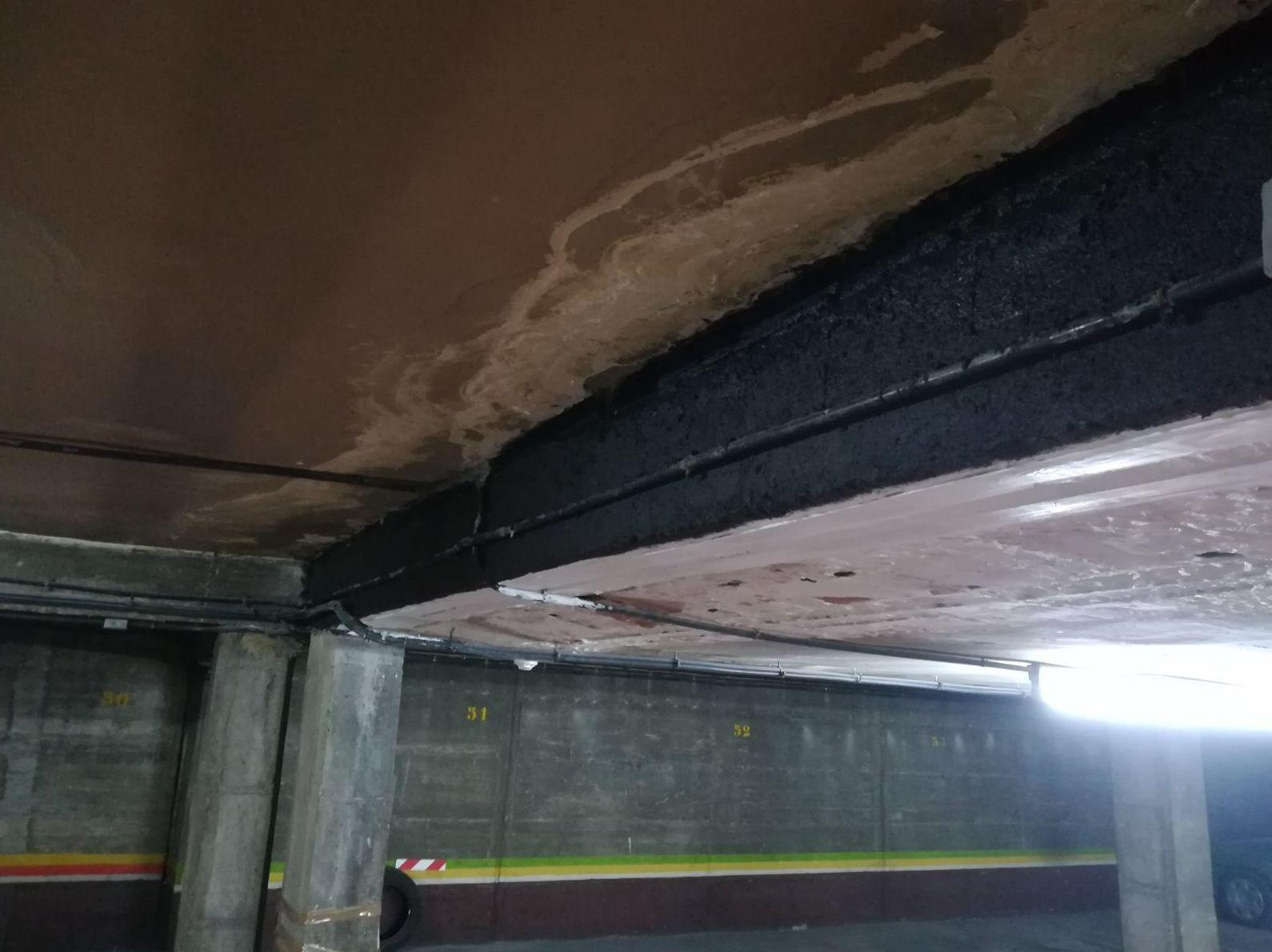 Refuerzo a flexión en parking utilizando el composite epoxi-carbono y su protección ignífuga. Carabanchel (Madrid)