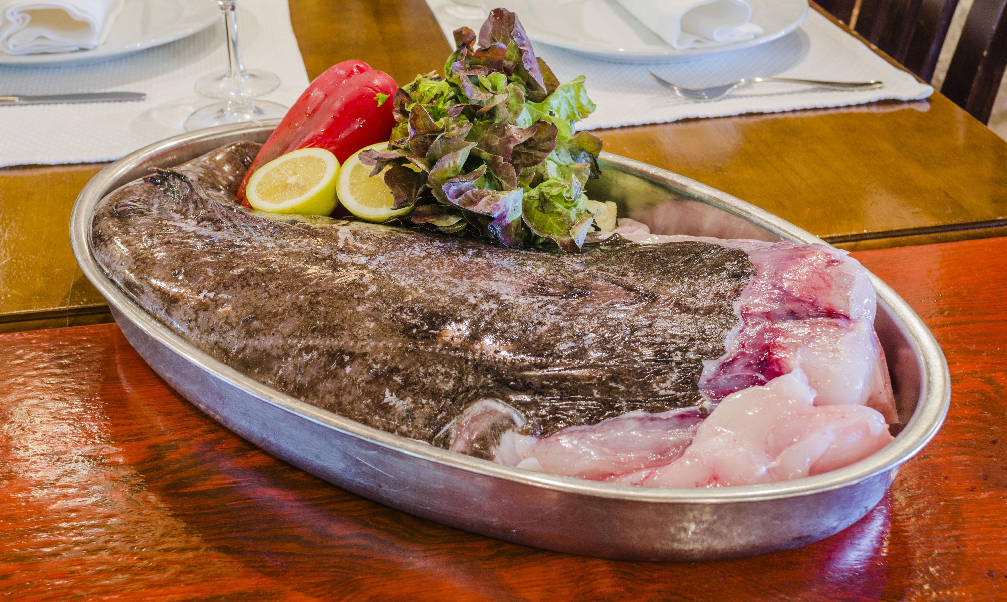 Comer buen pescado en Playa de las Américas, Arona