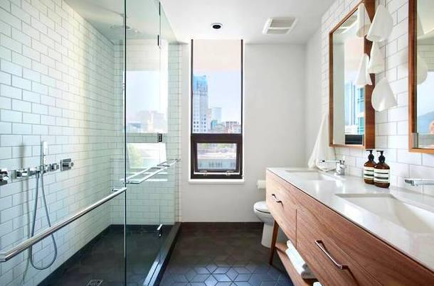 mueble de baño en madera y encimera de silestone blanco con dos lavabos