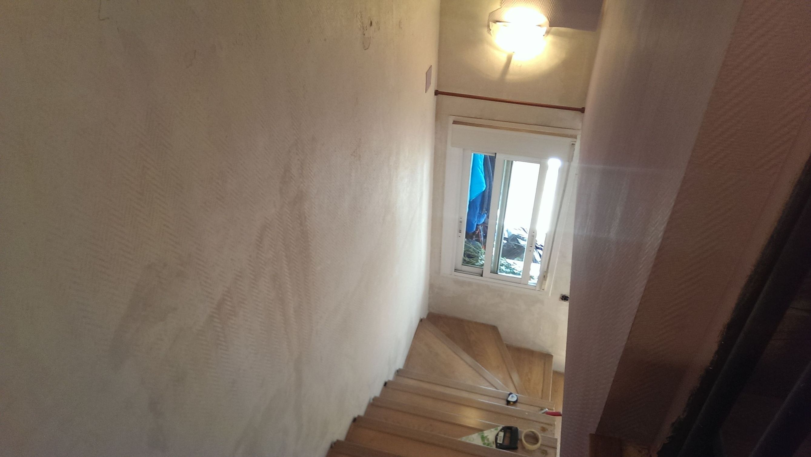 Reforma de pintura y suelos de tarima laminada en Getafe