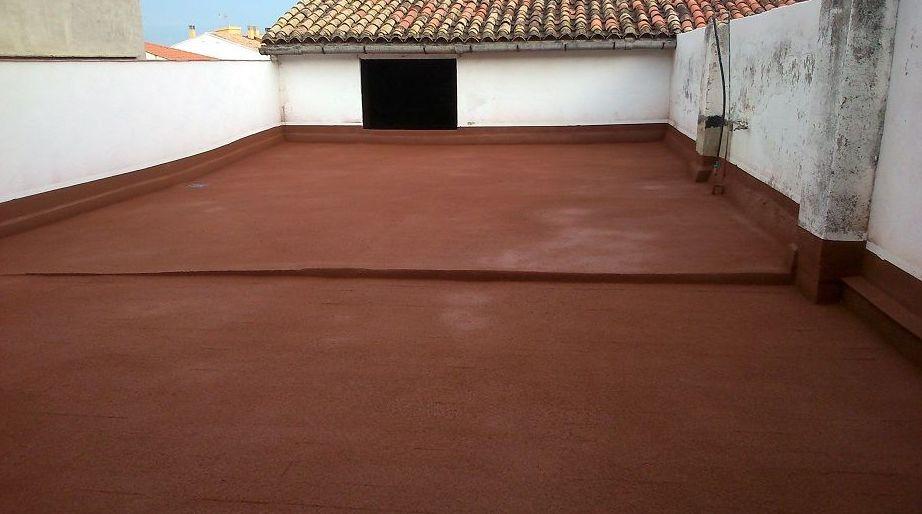 Terraza después de su restauración con corcho proyectado