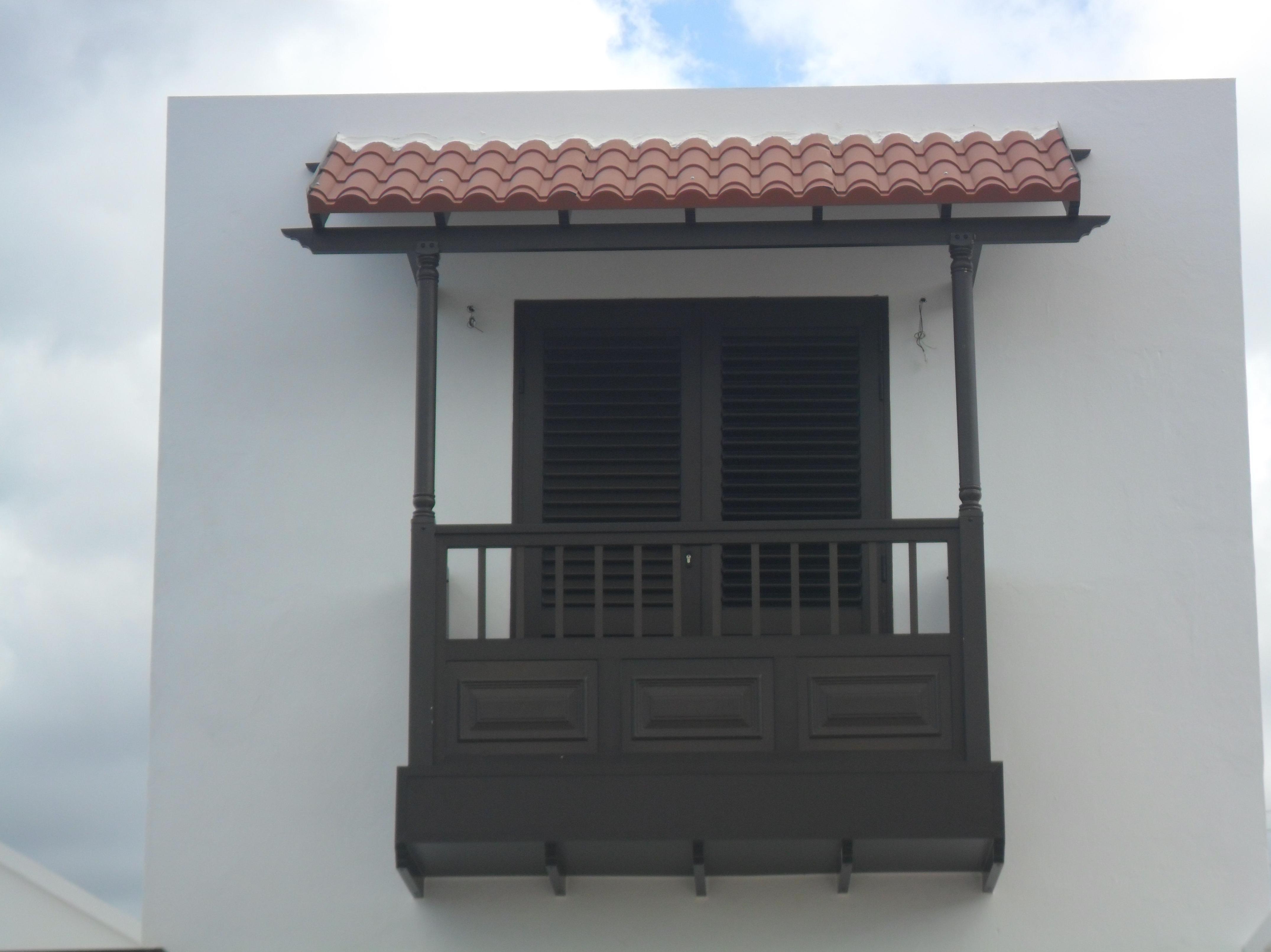 Pergola de teja con balcon