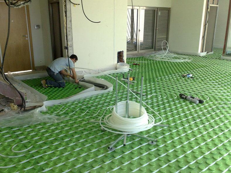 Instalación de suelo radiante en local comercial