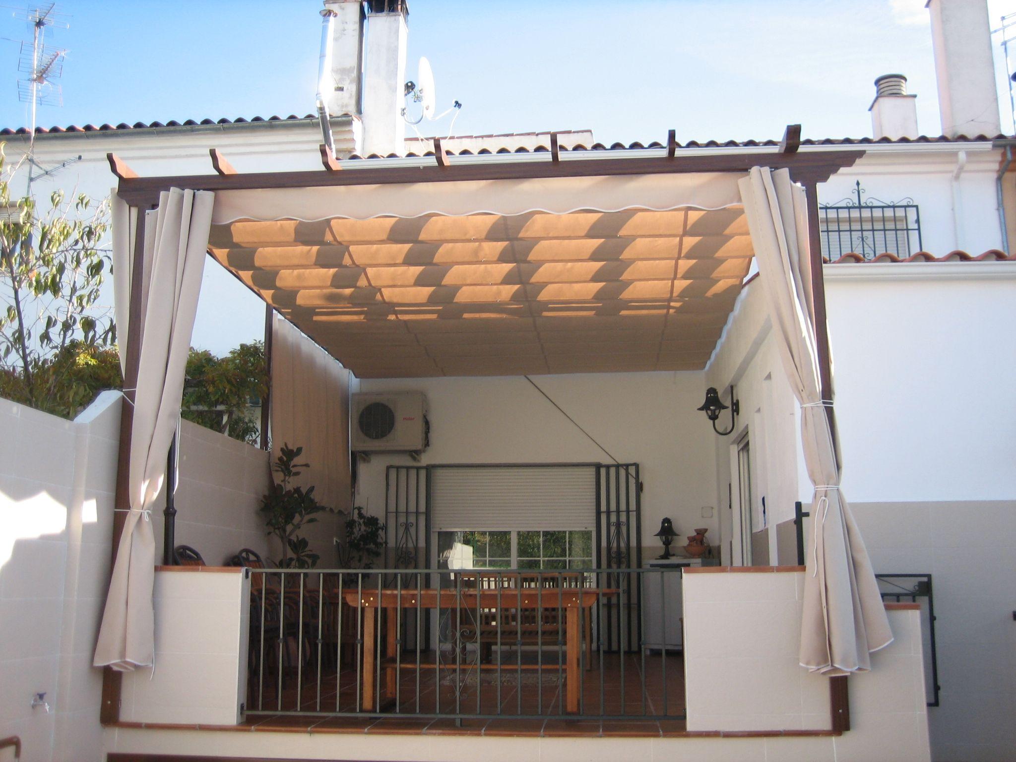 Cubrimiento de terraza con toldo