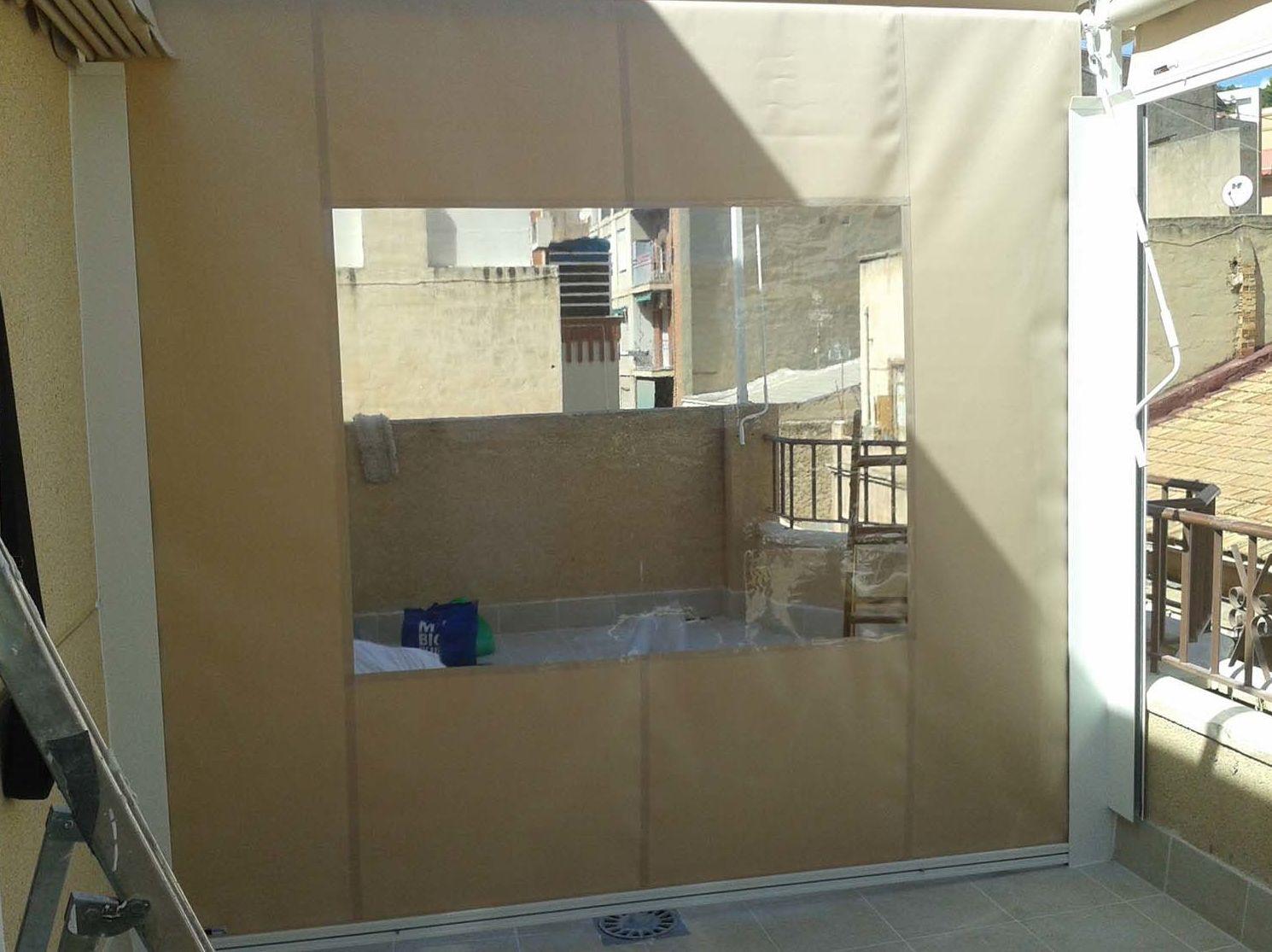Toldos telón con ventana
