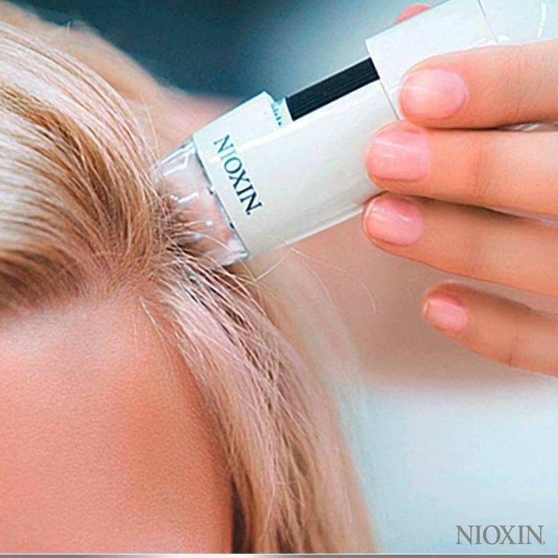 Tratamiento anti debilitamiento Nioxin: Peluquería y estética de Belleza Integral 10