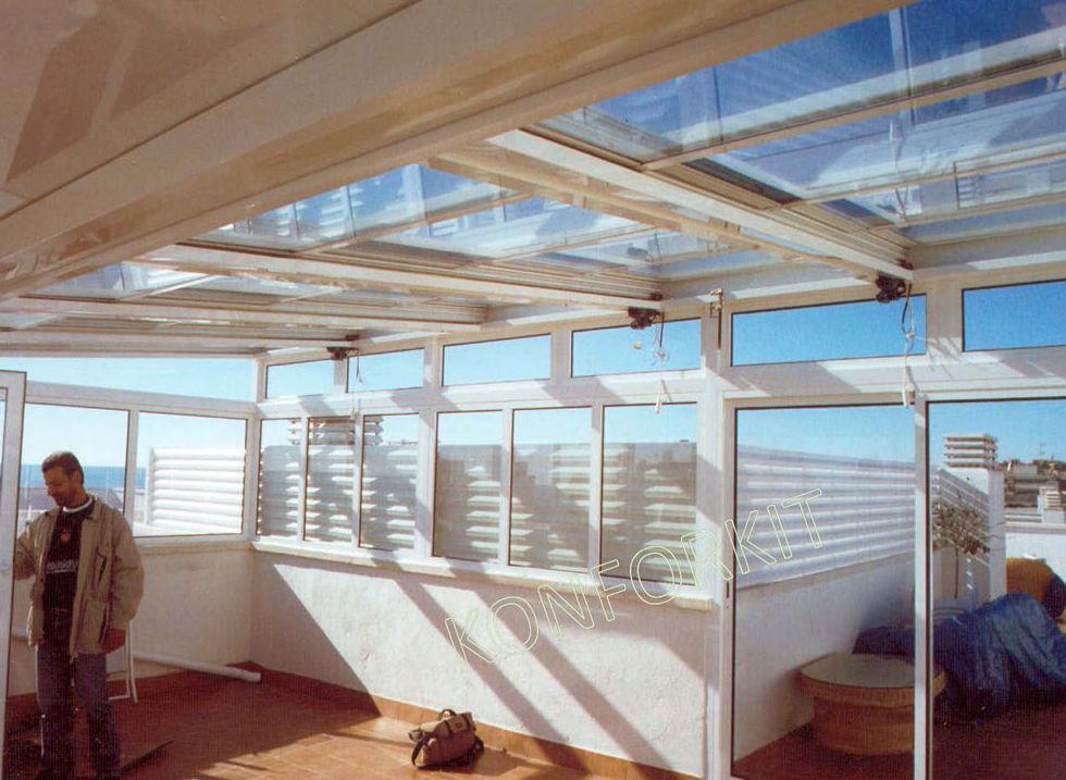 Cerramiento de terrazas e instalación de techos móviles
