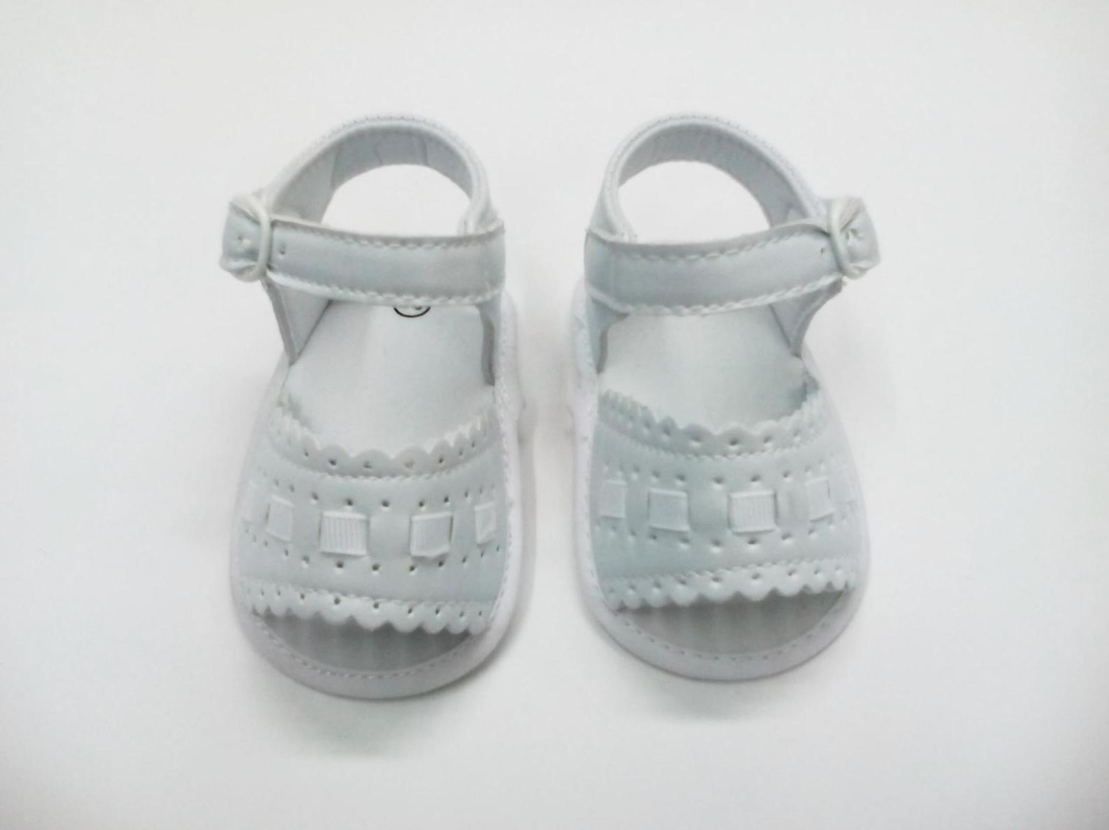 Sandalia bebé de niña blanca sin suela
