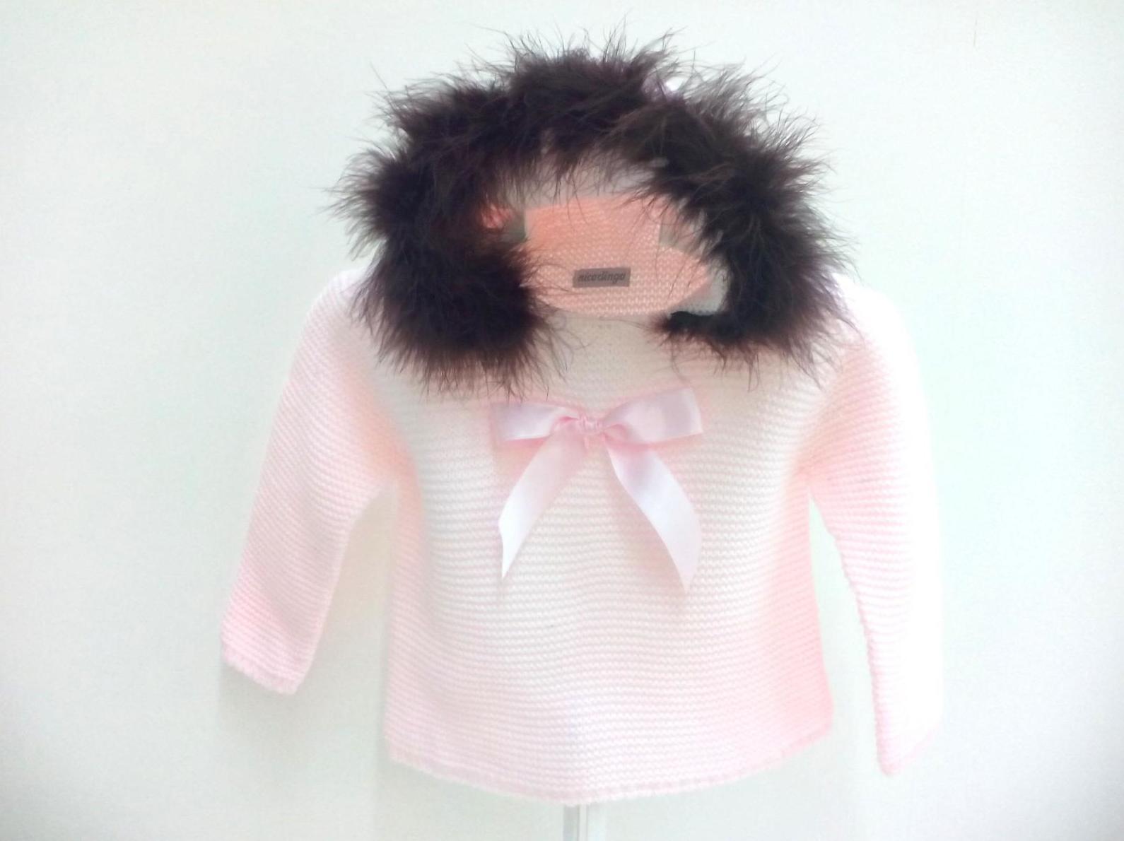 Jersey niña rosa con capucha de pelo de Nico Dingo