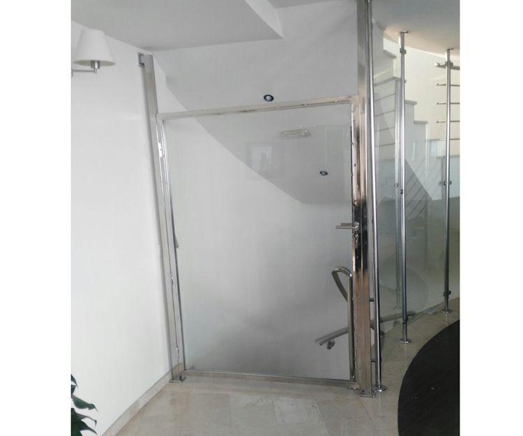 Puertas de cristal y acero inoxidable para oficinas