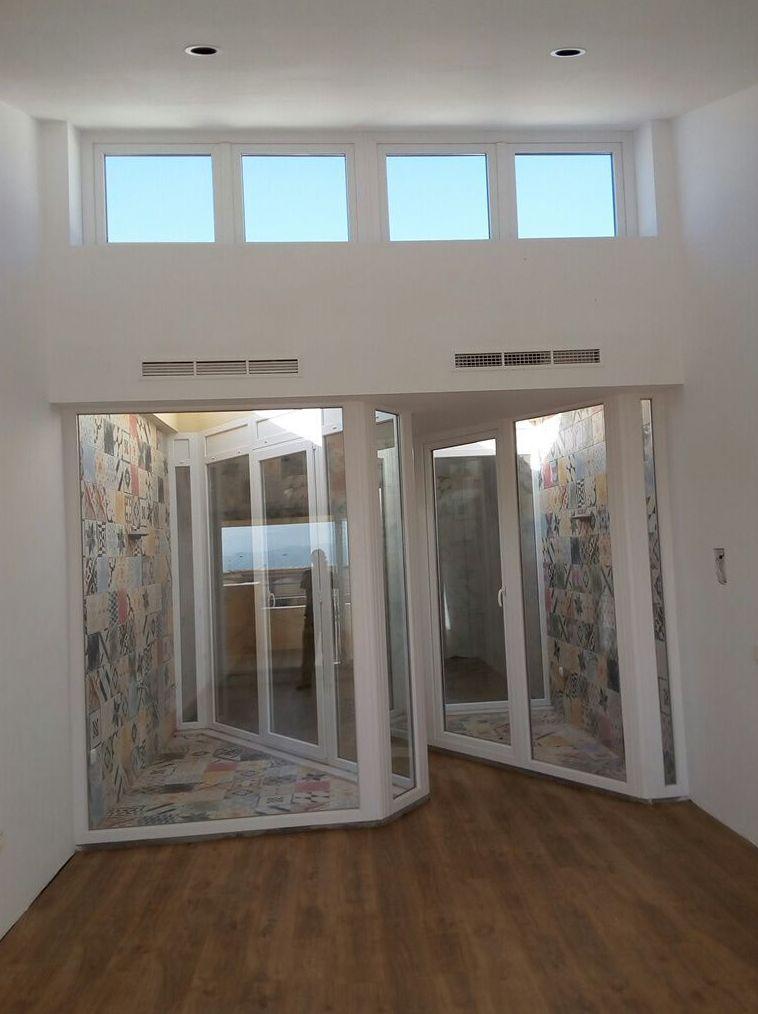 Fabricación y montaje de puertas y ventanas de PVC