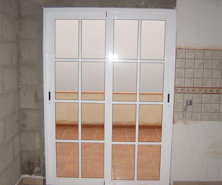 Puerta de aluminio correderas