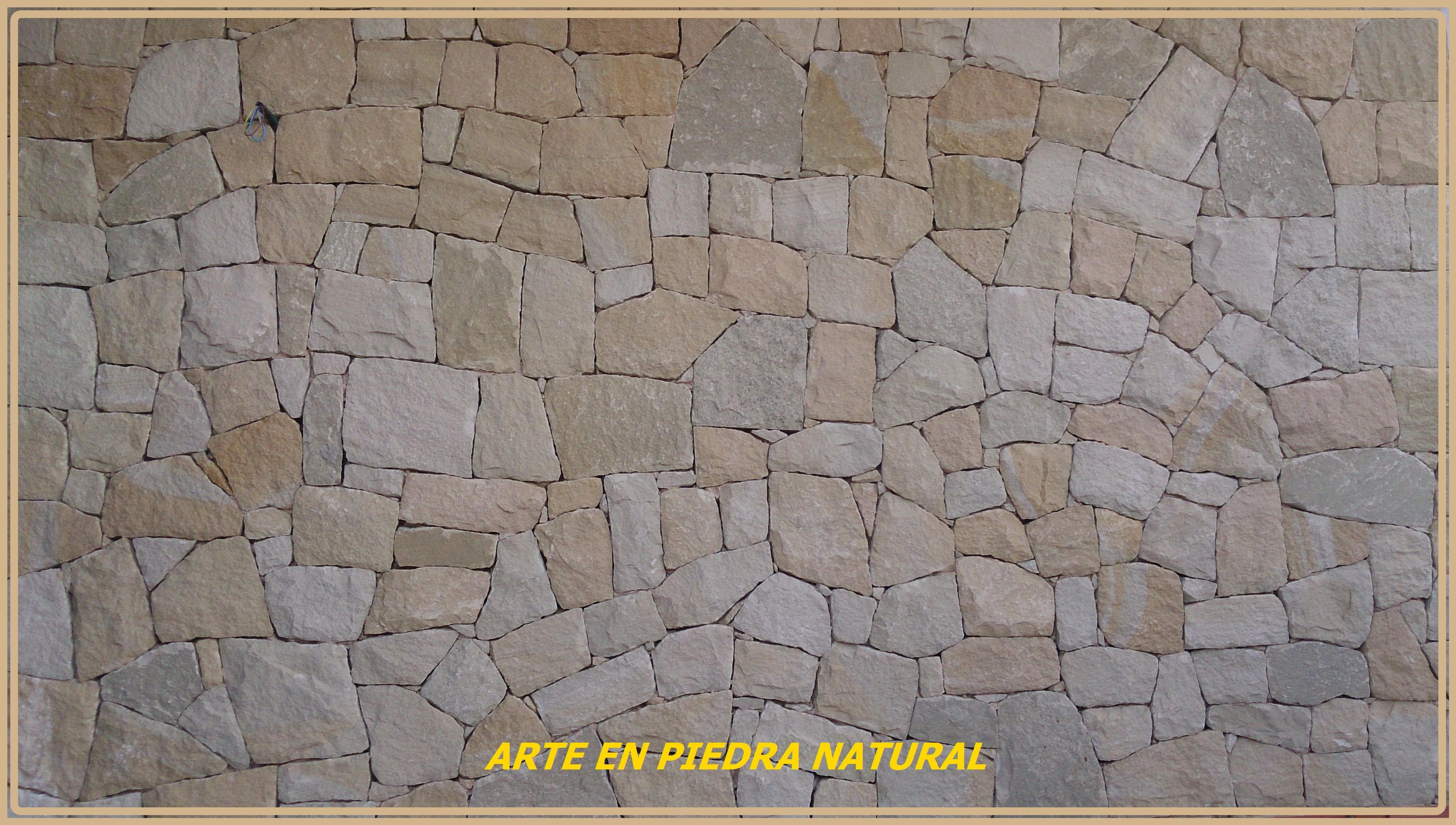 Fachada en piedra bateig