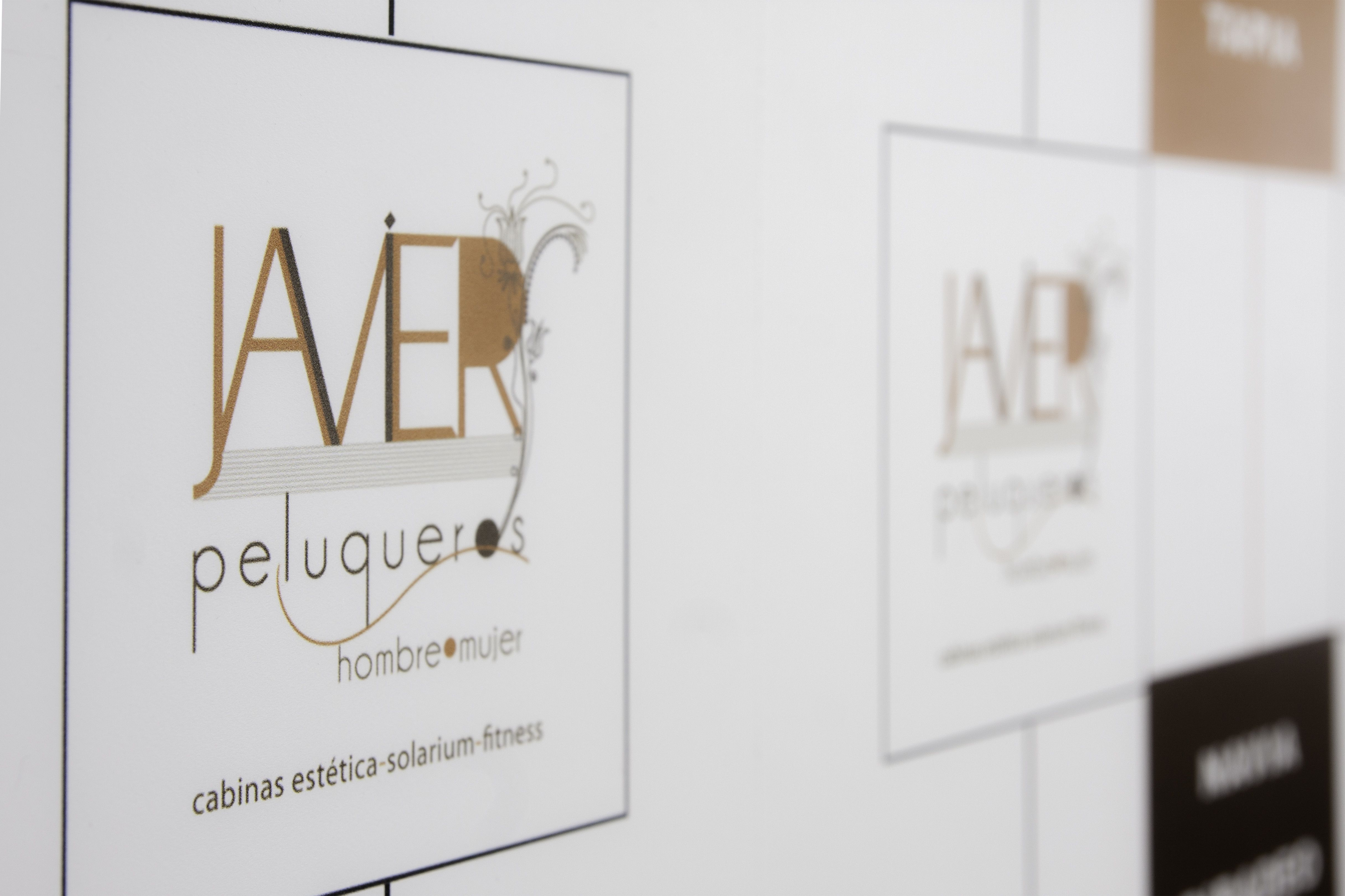 Logo publicitario de Javier Peluqueros