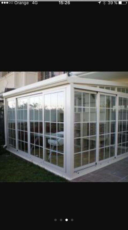 cerramiento de patio en corredera , con techo y doble cristal con barrotillo ingles