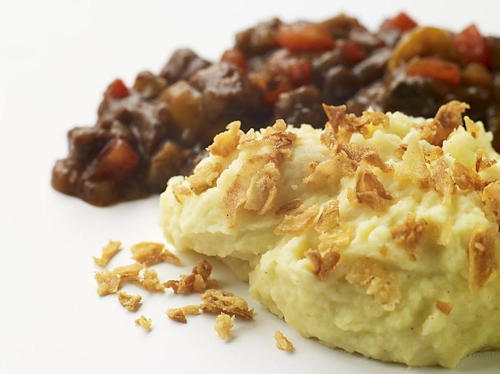 Puré de patatas con cebolla frita