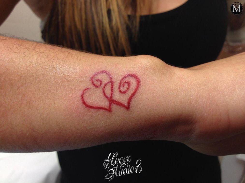 Tatuaje de dos corazones