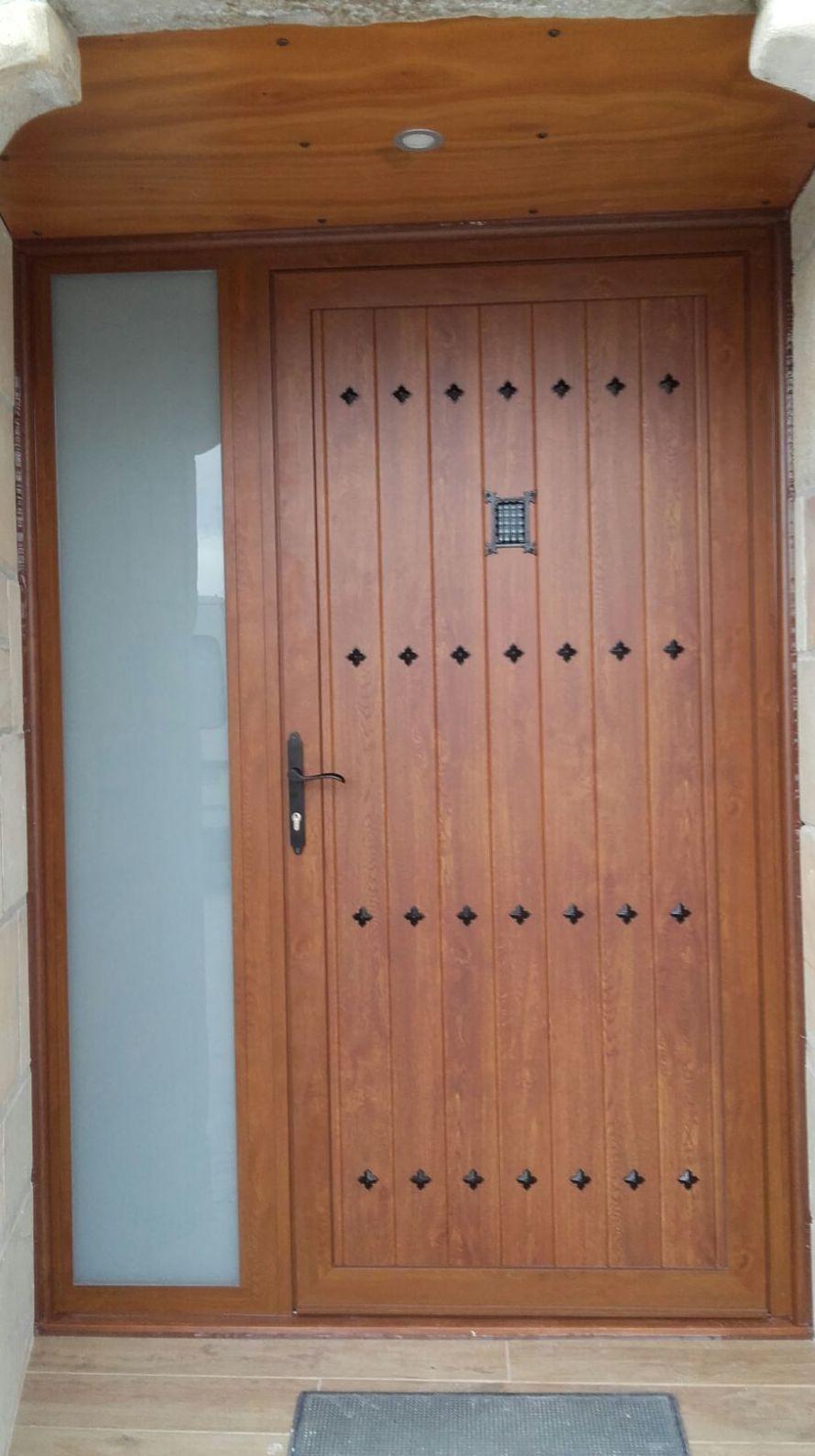 Puertas de aluminio imitaci n madera vitoria for Puertas de aluminio precios en rosario