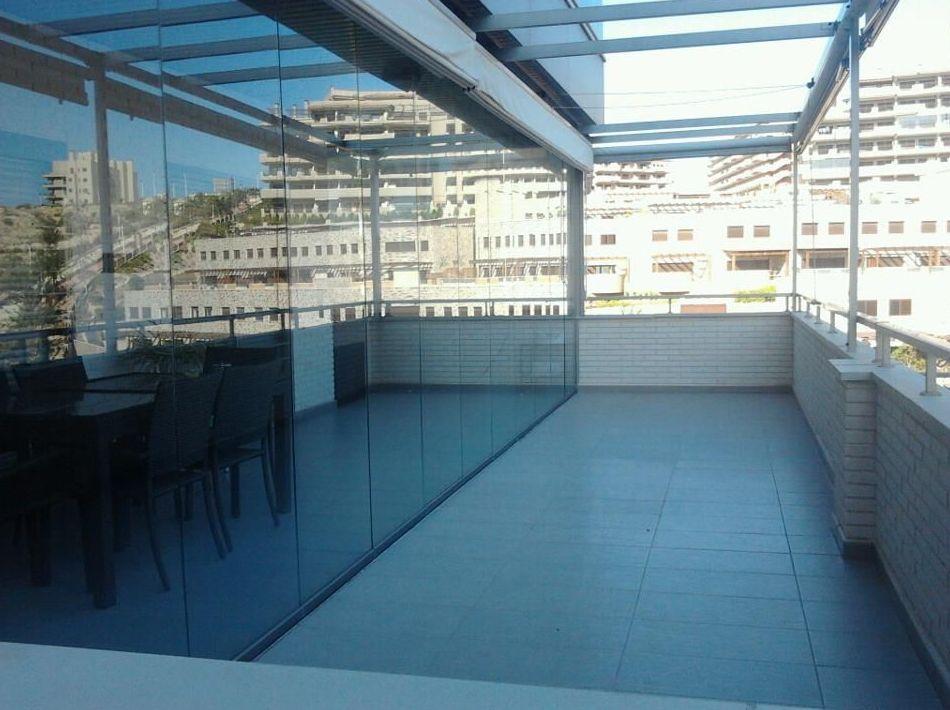 Instalación de cortinas de cristal en Alicante