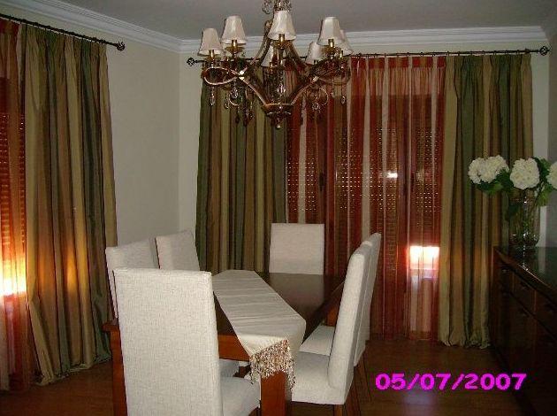 cortina con caidas  en salon